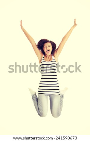 Young happy caucasian woman jumping in the air. - stock photo