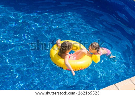 young happy child girl having fun on tropical background, kid enjoying summer vacations, beach holidays - stock photo