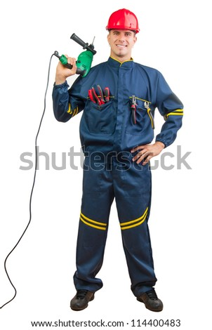 Young happy construction worker holding drilling machine isolated on white. - stock photo