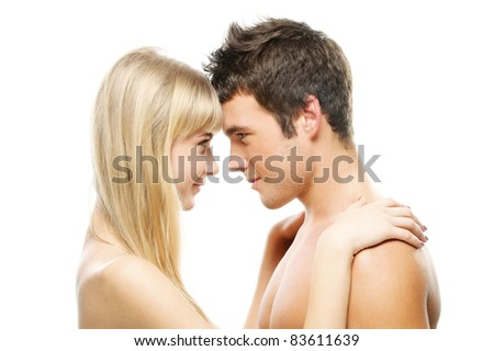 Young happy couple: beautiful smiling blonde woman and brunette man looking at each other against white background. - stock photo