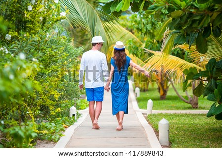 Young happy couple during beach tropical vacation - stock photo