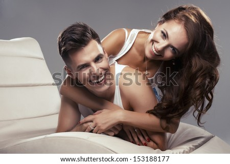 Young happy couple hugging each other  - stock photo