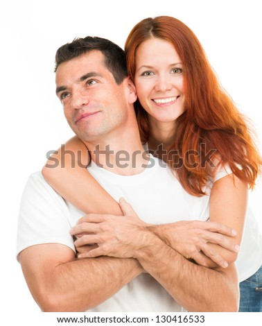 Young happy couple hugging on white background - stock photo