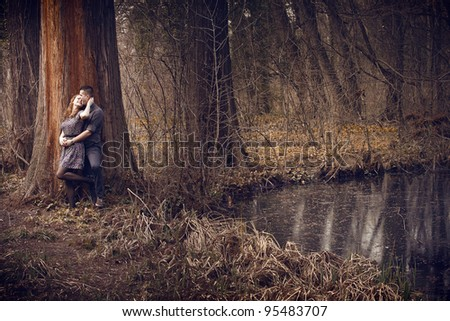 Young happy couple hugging with passion outdoors - stock photo