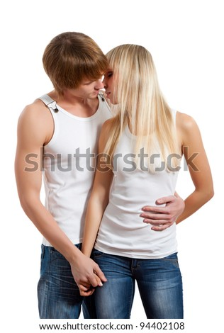 Young happy couple in love kissing, woman and man hug each other sensual kiss, isolated over white background, concept of passion, sensuality. - stock photo