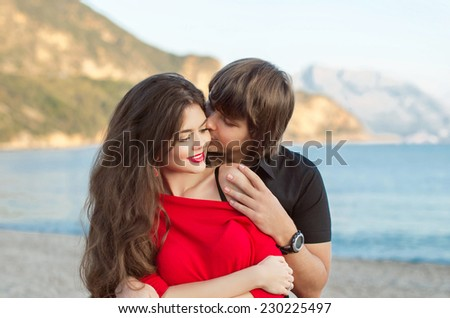 Young happy couple in love outdoor portrait - stock photo
