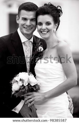 Young happy couple just married - BW photo - stock photo