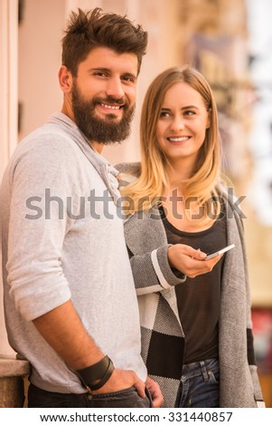 Young happy couple on a walk in the city - stock photo