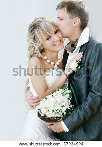 young happy couple on their wedding day - stock photo