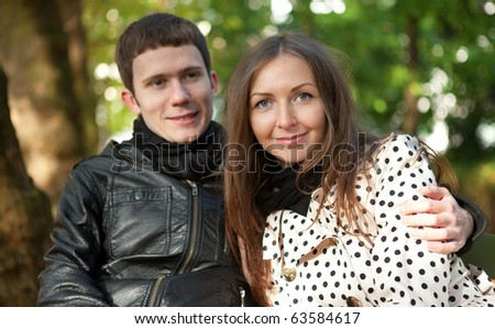 Young happy couple outdoors at fall - stock photo