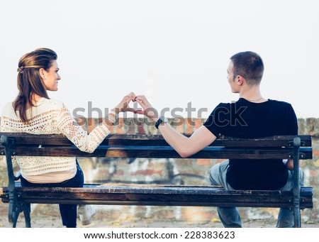 Young happy couple posing outdoor. Autumn scenery. Filtered images - stock photo