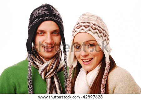 Young happy couple smiling on white background - stock photo