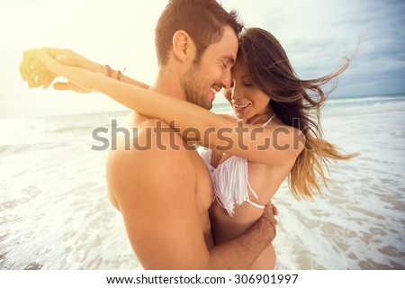 young happy couple with draw heart on tropical beach. Honeymoon - stock photo