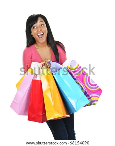 Young happy excited black woman holding shopping bags - stock photo