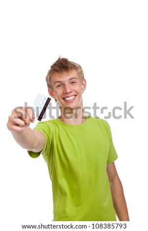 young happy excited smile man holding credit card, handsome guy wear green shirt, isolated over white background - stock photo