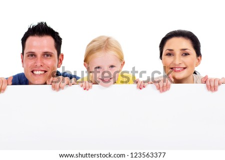 young happy family behind white board - stock photo