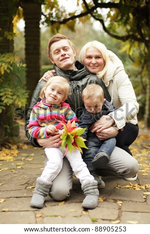 young happy family in autumn park - stock photo