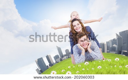Young happy family of father mother and daughter - stock photo