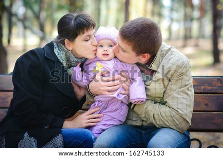 Young happy family with a small child - stock photo