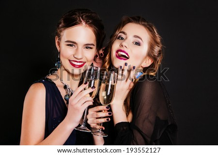 Young happy fashion women celebrating the event. - stock photo