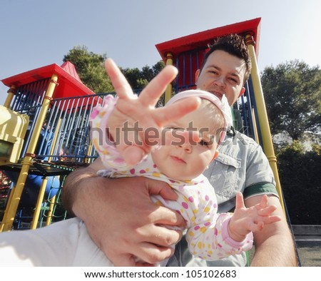 Young happy father and daughter sun summer day in the park - stock photo