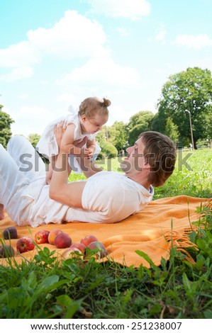 Young happy father with daughter in the park - stock photo