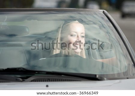 young happy girl driving cabrio car, on sunset light - stock photo