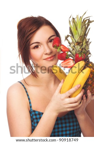 Young happy girl in blue dress with fruits in her hands - stock photo