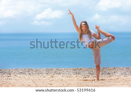 young happy girl on beach - stock photo