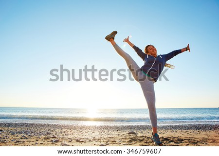 young happy girl with dreads jumping on the beach. Turkey, Antalya. - stock photo