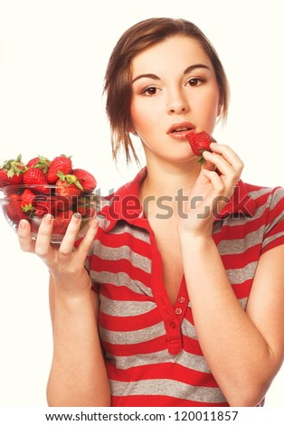 Young happy girl  with fresh  strawberries - stock photo