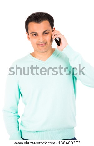 Young happy guy talking on cell phone - stock photo
