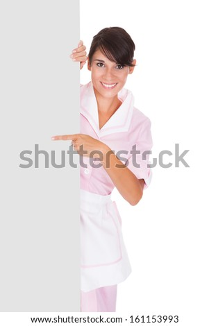 Young Happy Maid With Empty Bill Board Over White Background - stock photo