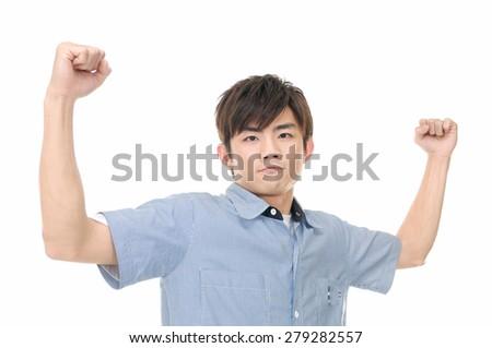 Young happy man celebrating success - stock photo