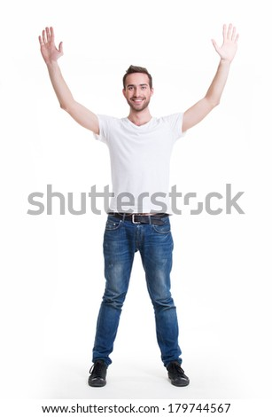 Young happy man in casuals with raised hands up - isolated on white. - stock photo