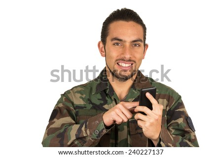 young happy man in military uniform using cell phone mobile isolated on white - stock photo