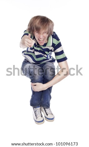 Young happy man jumping over white background - stock photo