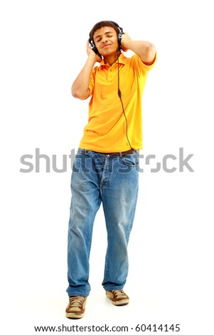 Young happy man listening to music and singing - stock photo