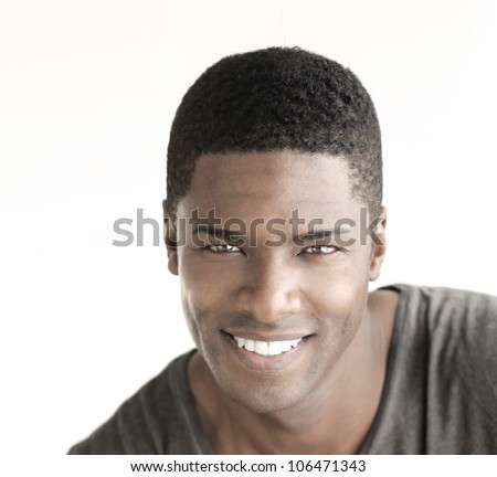 Young happy man with big natural smile against white background - stock photo