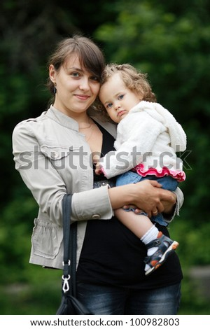 young happy mother with daughter - stock photo