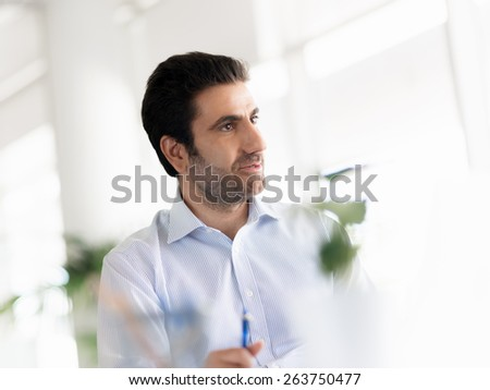Young happy professional in office - stock photo