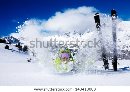 Young happy skiing woman have fun throws snow - stock photo