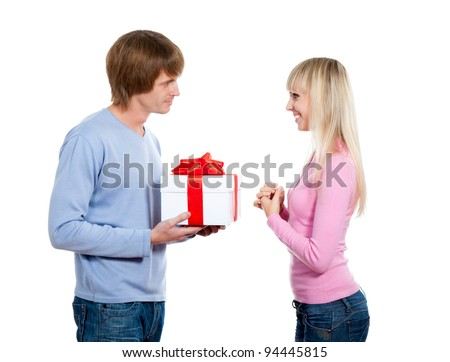 Young happy smile couple, give present gift box, looking to each other giving presenting, isolated over white background - stock photo