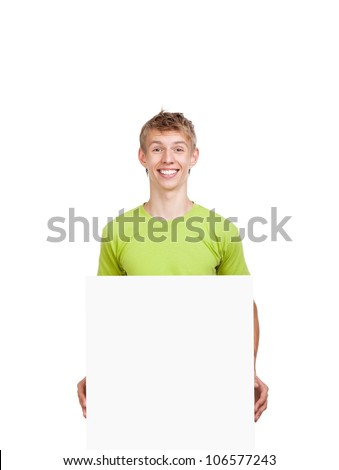 young happy smile man standing hold blank board, handsome guy wear green shirt, isolated over white background, studio shoot - stock photo