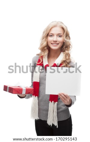 young happy smiling casual  blond woman holding red christmas gift and sign isolated on white - stock photo
