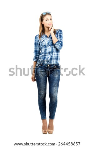 Young happy smiling casual woman looking at camera. Full body length portrait isolated over white background - stock photo