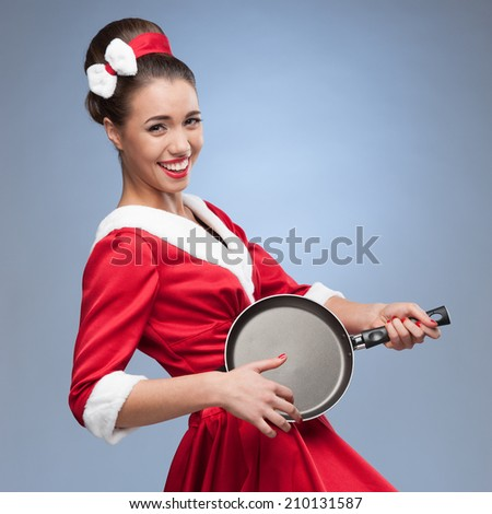 young happy smiling caucasian brunette woman in winter clothing holding christmas gift isolated on white - stock photo
