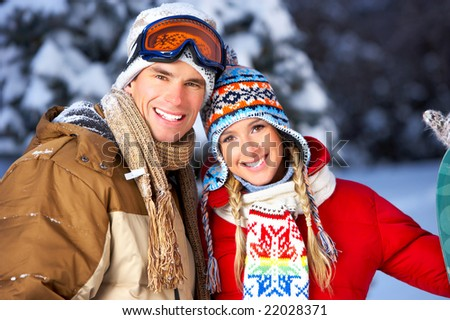 Young  happy smiling couple in love. Winter - stock photo