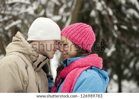 Young happy smiling couple in winter - stock photo