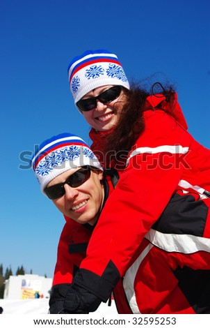 Young happy smiling couple. Ski resort. - stock photo